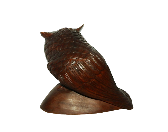 Carved Wooden Owl on Rock